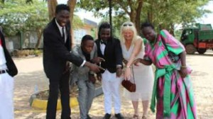 Ugandan-singer-Ronald-Ssemawere-his-bride-Mona-Lisa-Larsson-with-friends-and-relatives-on-their-wedding-day
